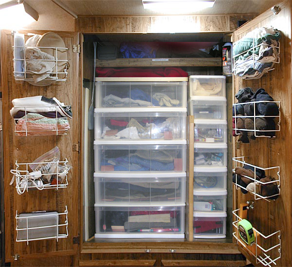 Storage ideas for RV Closets - When you don't have enough space for all your clothes but you still want to look nice while traveling, it's important to organize what space you do have! Make the most of ALL the space by adding some wire baskets to the inside of the closet door.
