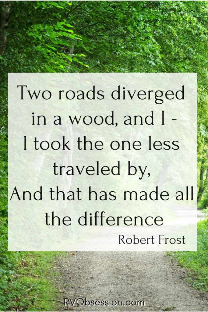 Travel Quote by Robert Frost - on a background of a road in a forest