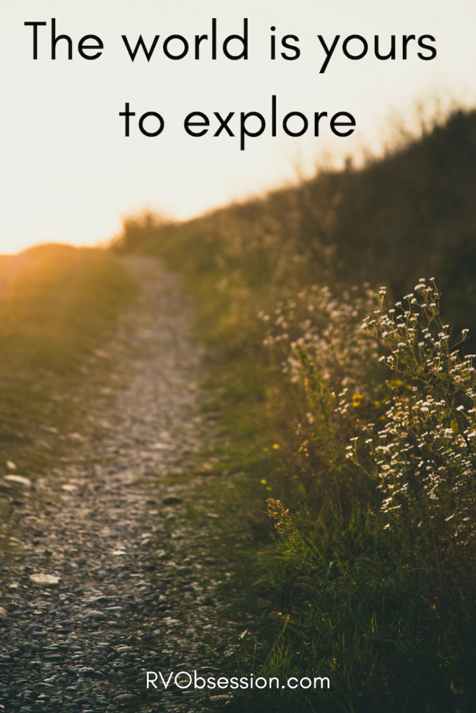 Travel Quotes Inspiration - The world is yours to explore. The background is a country path