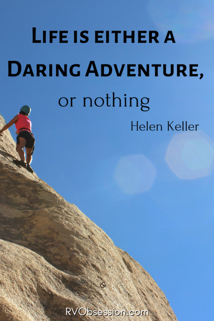 Travel Quotes Inspirational by Helen Keller - Life is either a daring adventure, or nothing. The background shows a person climbing a rock wall.