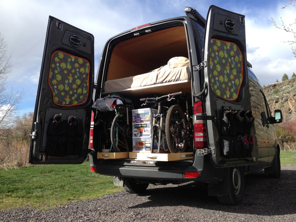 Sprinter Van Conversions - I love the idea of living so small and mobile, but with all the creature comforts of home. You can tell that this couple prioritises having fun when they're out on their adventures; with room for the toys inside their Sprinter van conversion.