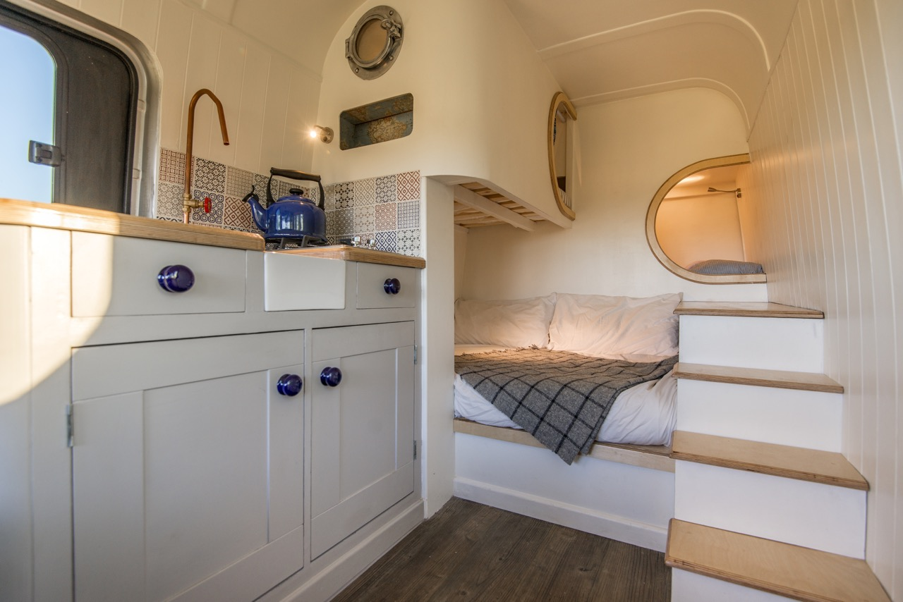 Sprinter Van Conversions - I love the idea of living so small and mobile, but with all the creature comforts of home. Designed to sleep a family of four, this sprinter van conversion is stunning.