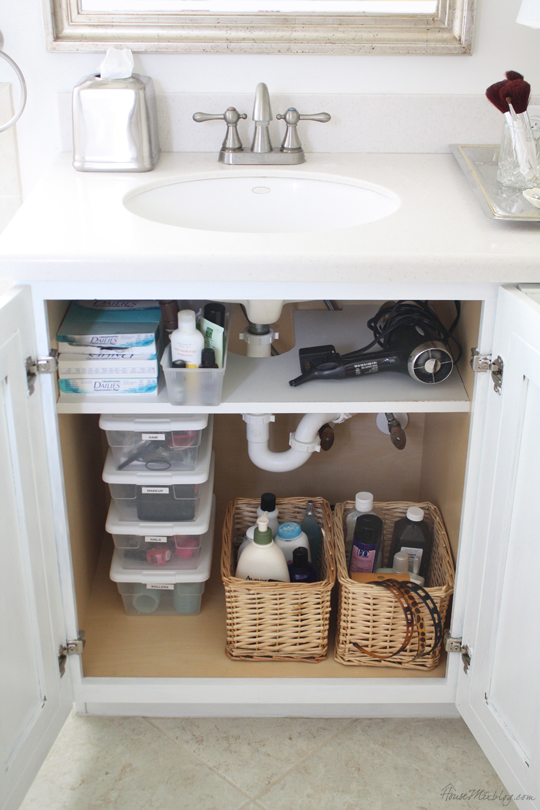 Small Bathroom Storage Ideas - build custom shelves around drain pipes to turn that awkward space into something useful.