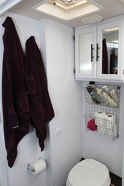 Small Bathroom Storage Ideas - Shelves or baskets above the toilet are the perfect place for storage.