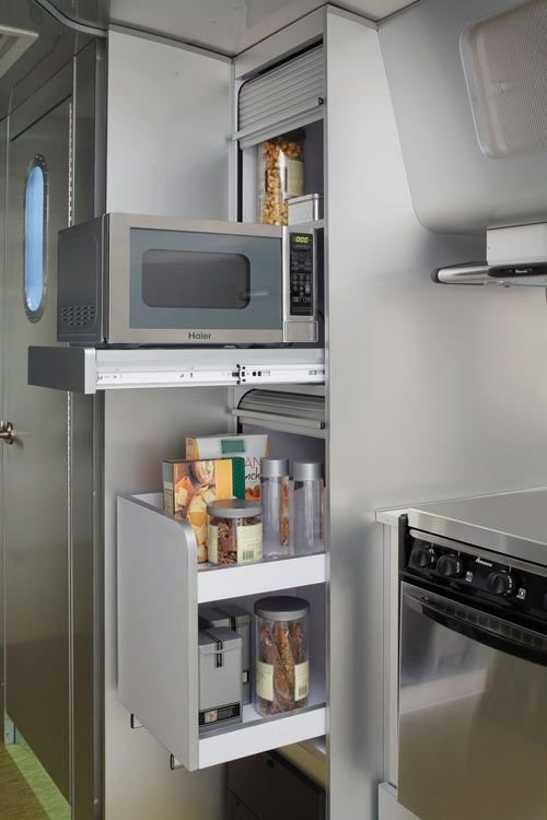 Small Kitchen Storage Ideas - Hideaway the microwave so that it can go into a cupboard sideways and doesn't take up precious counter space.