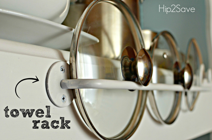 Small Kitchen Storage Ideas - Use a towel rack to store pot lids - when you need to utilize all the space you can in your small RV kitchen.