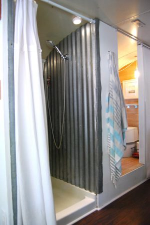 RV Bathroom Renovations - corragated metal on the walls of the shower and it still manages to look cool and funky!?