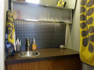 RV Bathroom Renovations - adding stick on backsplash tiles is both easy and inexpensive
