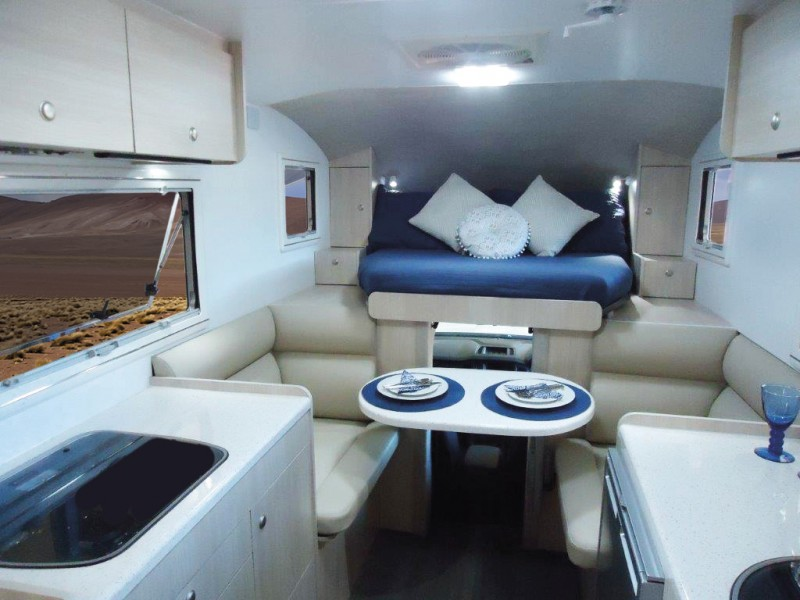 The Best Compact Motorhome - Explorer Spirit has a unique pull-out bed style that allows you to utilise the space above the cab without have to clamber up or over your partner.