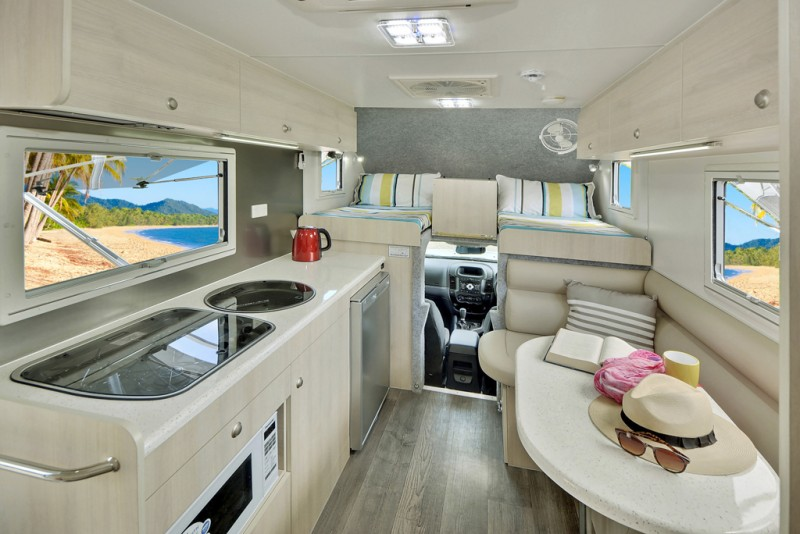 Best Compact Motorhome - The Explorer Motorhomes have a big enough space for the kitchen and a dinette for two.
