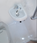 Small RV Trailers bathroom - I don't understand why they would bother putting in a vanity, if it's so small that you can't even get your hands under the tap?