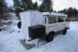 ... Small RV Trailers Bathroom - A shower with a rain shower head built into the rear