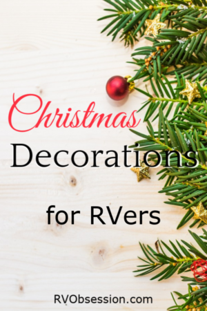 Christmas decorations on a wooden background. Caption: Christmas Decorations for RVers