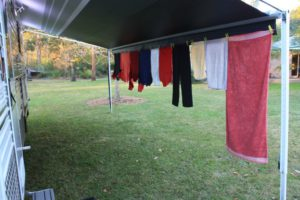 laundry drying from a line under the RV awning
