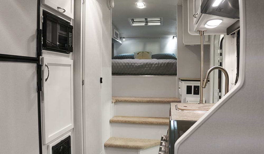 Interior of Escape 5.0 fifth wheel camper showing the bed end