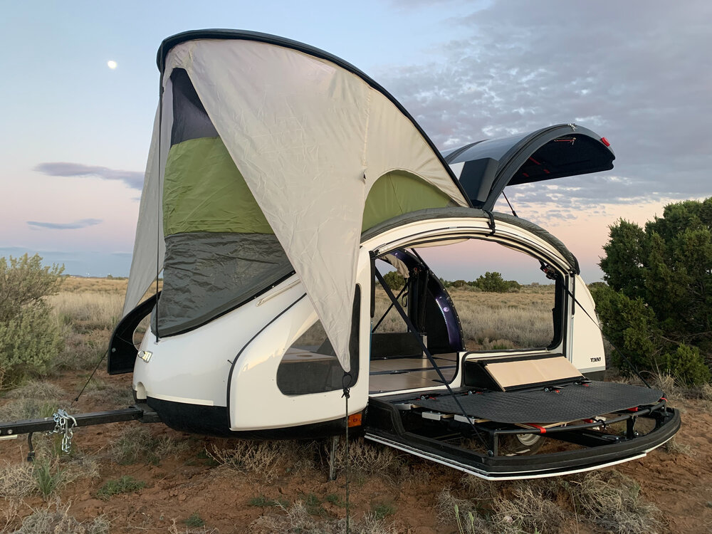 Small teardrop camper with pop-up roof and open sides
