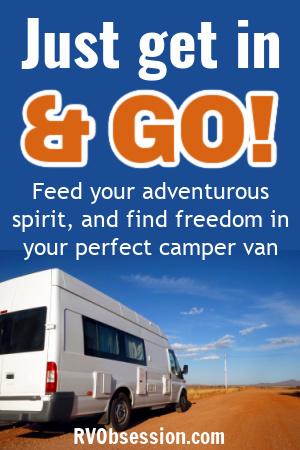 White camper van on orange outback road.