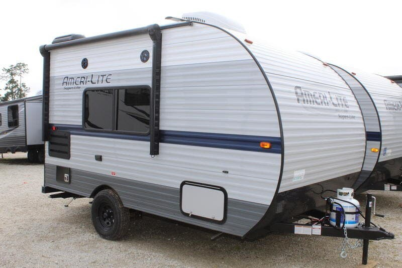 Exterior side view of a small super lite travel trailer.
