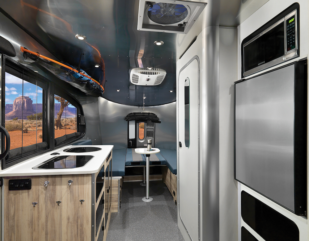 Interior of Airstream Basecamp lightweight travel trailer looking towards the rear.