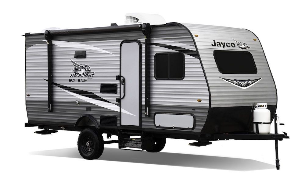 Exterior side view of small Jay Flight SLX 7 travel trailer.