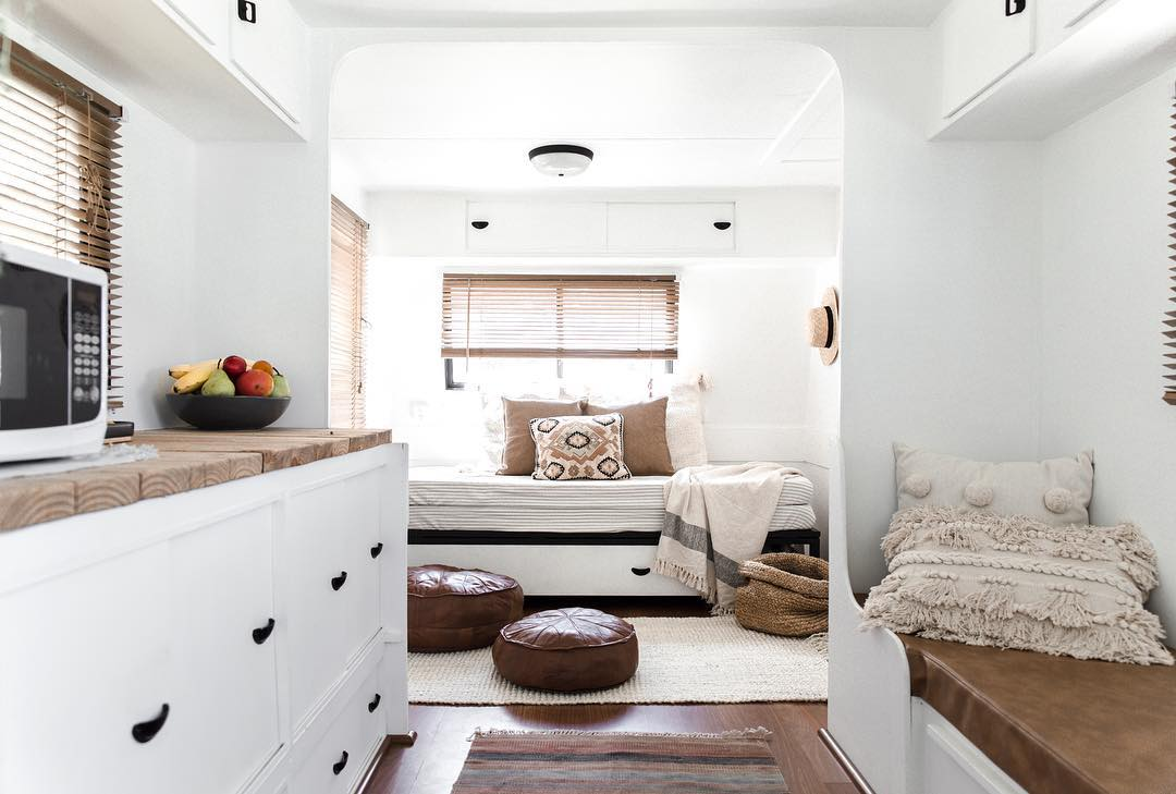 Interior of renovated caravan with mostly white and a few brown accents