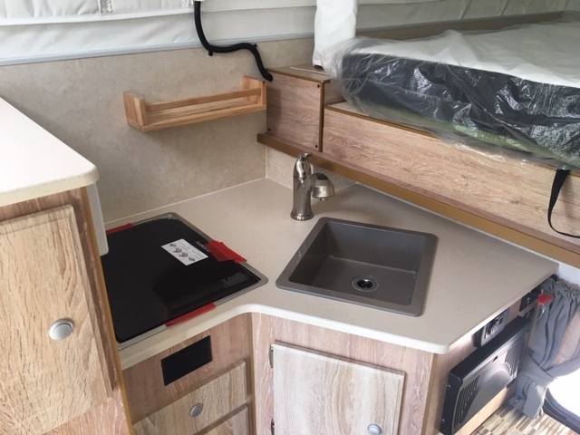 Kitchen in an Northstar 650SC Pop Up Truck Camper