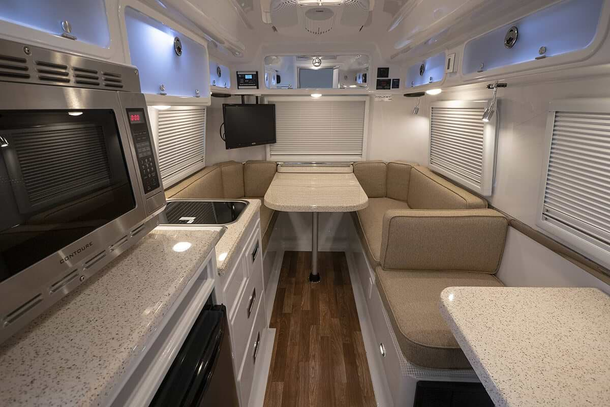 White interior of a Oliver Travel Trailers looking towards the rear