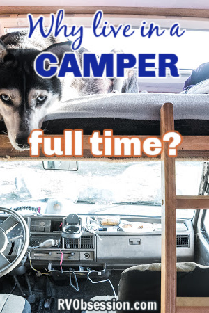 Interior of a Class C camper showing a dog in the bed above the cab; with text overlay: Why live in a camper full time?