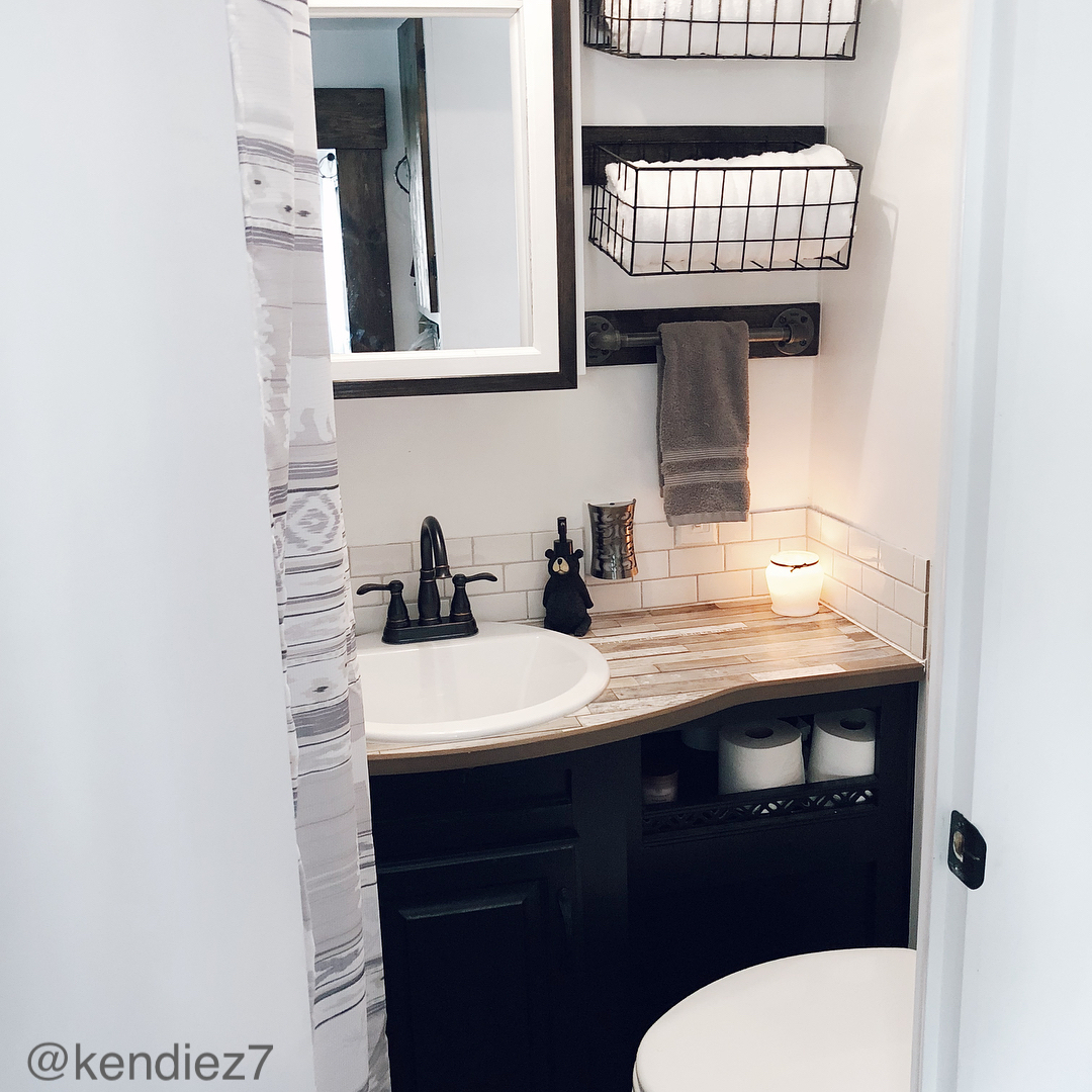 Simple black and grey decor in a small RV bathroom