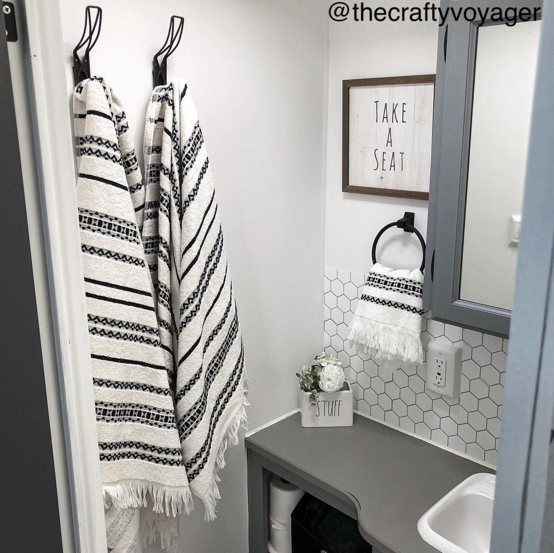 Small RV bathroom with black, white and grey decor