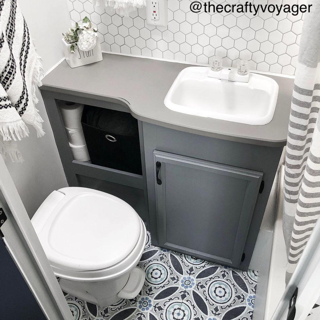 Tiny RV bathroom with grey toned decor