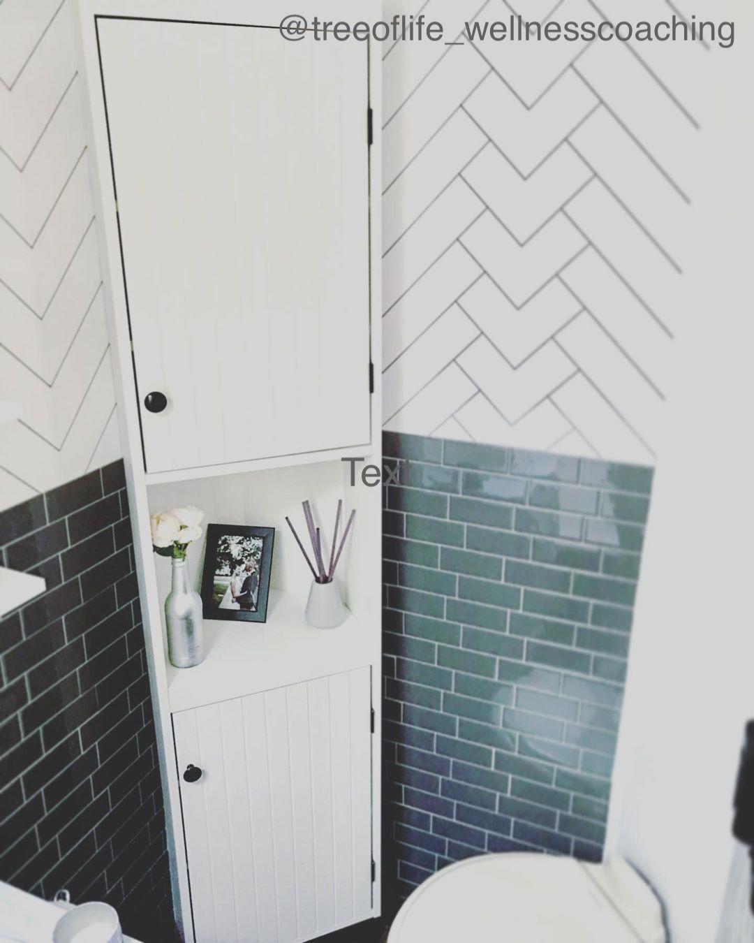 White corner cabinet in a very small RV bathroom