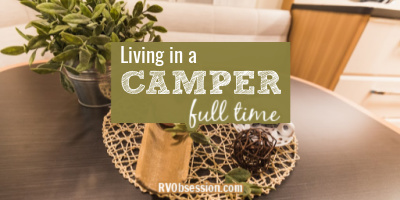 Table decor in an RV, with text overlay: Living in a camper full time.