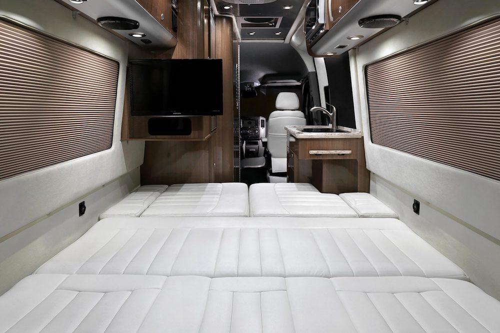 Bed area of a Airstream Interstate camper van.