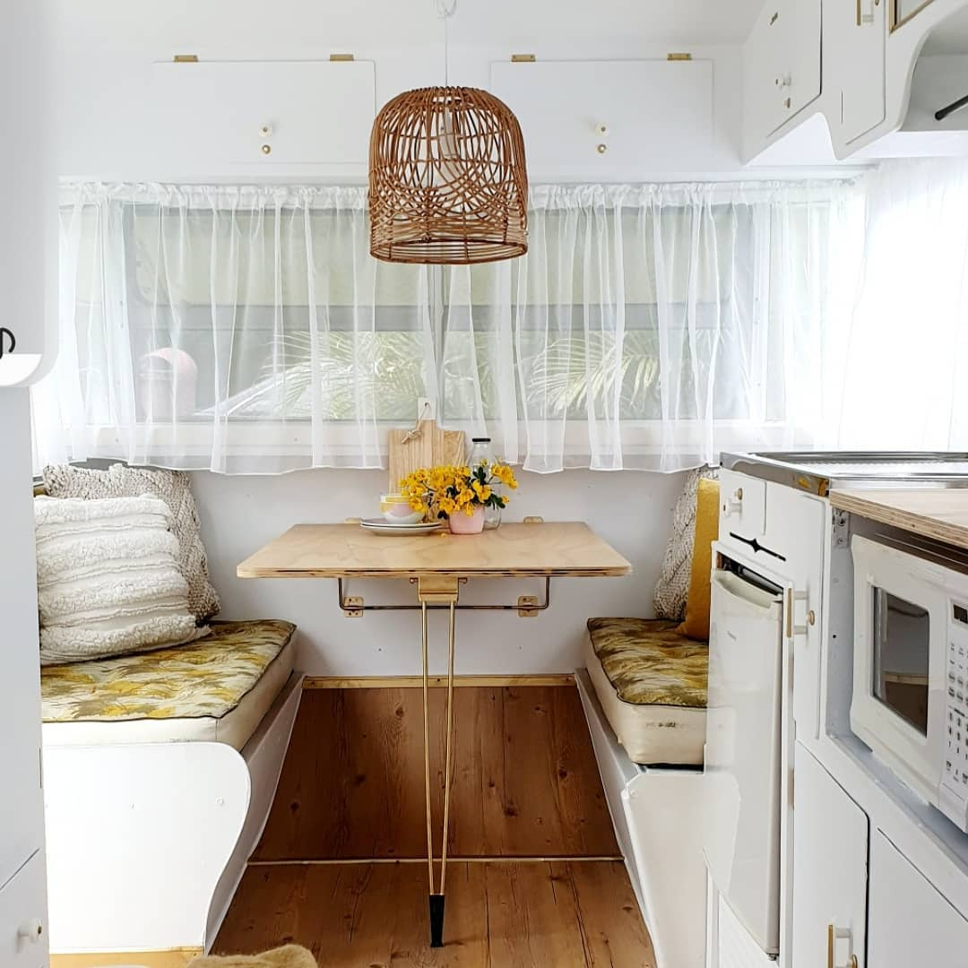 Dining area inside a newly decorated vintage camper.