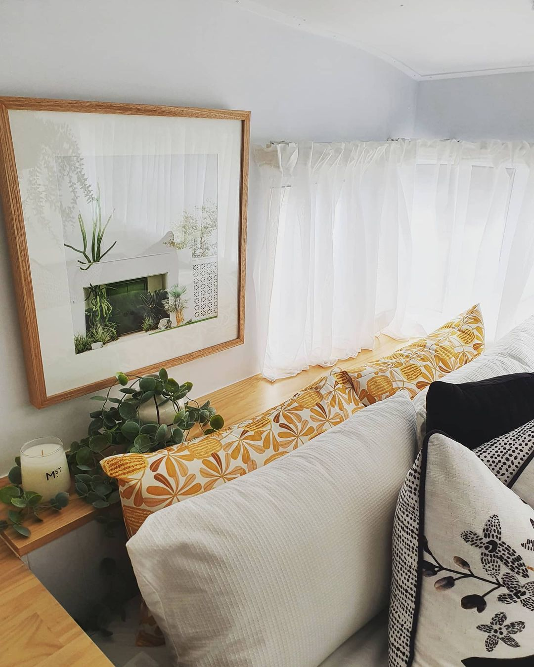 Bedroom decor in a renovated vintage camper.