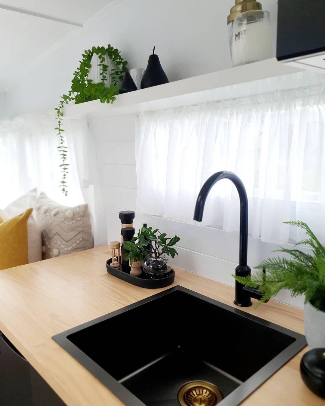 Kitchen area inside a remodeled camper.